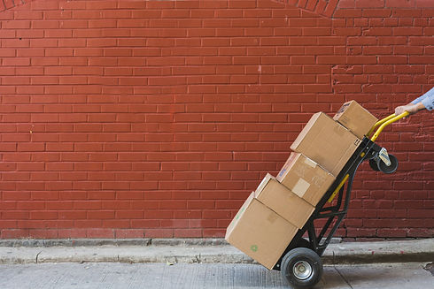 shipping-boxes-in-front-of-red-brick.jpg