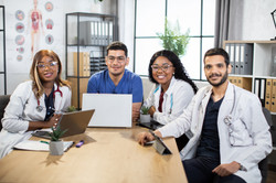multiracial-doctors-with-gadgets-coworking-at-offi-TJGX8KS