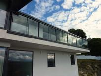 modern-house-with-glass-balustrade.jpg