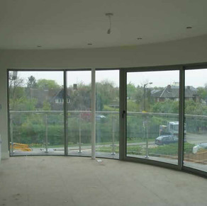 curved glass sliding doors cambridge.jpg