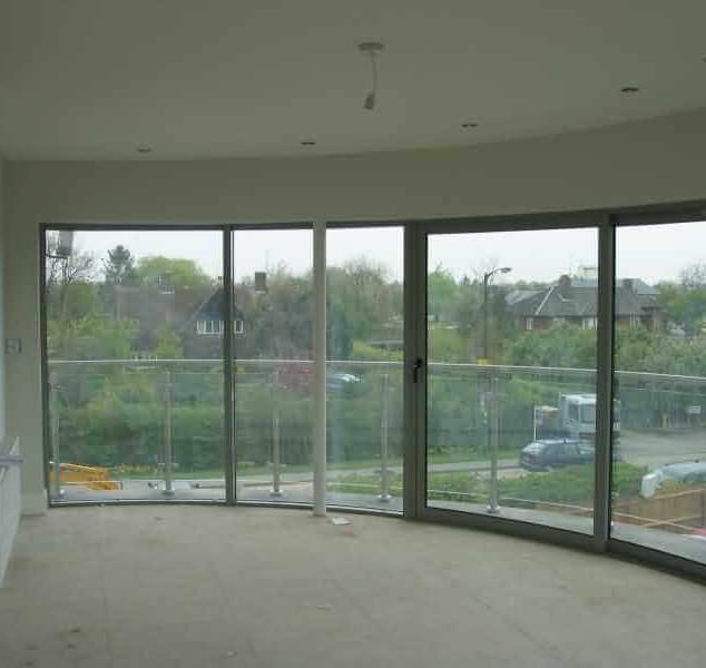 curved glass sliding doors cambridge.jpg