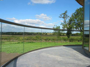 Arched glass - a lovely curved glass balcony in plymouth cornwall.jpg