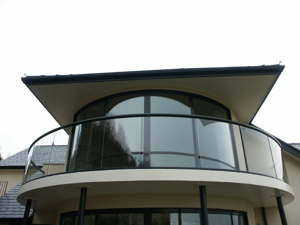 beautiful curved glass balcoiny and curved sliding doors north wales