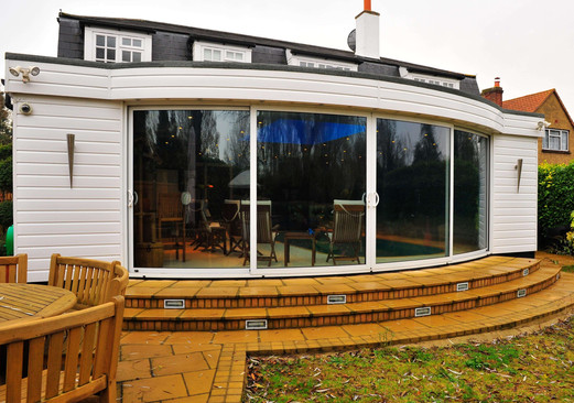 Balcony curved doors and decking.jpg