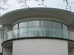 Curved slidering doors and fixed units manchester.jpg