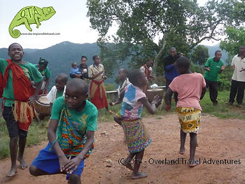 The villagers welcome us to Bwindi Impenetrable Forest, Uganda, Kenya to Kigali Adventure, OTA