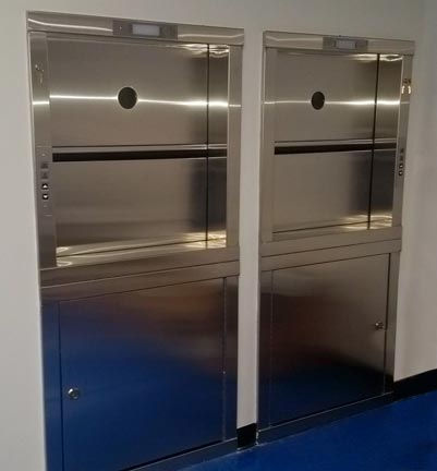 2 Stainless steel bi-parting hoistway doors with motor access panels