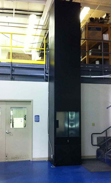 Mezzanine lift with powder coated siding