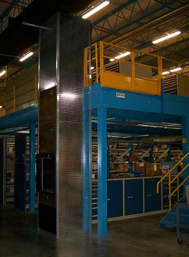 Mezzanine lift with diamond plate siding for Kimberly Clark