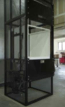 Mezzanine lift installed with custom bi-parting hoistway door