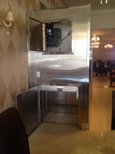Motor top dumbwaiter with custom stainless steel siding and hoistway doors done by customer