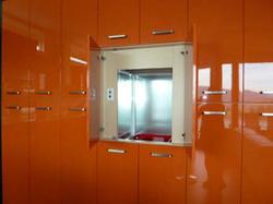 Orange dumbwaiter