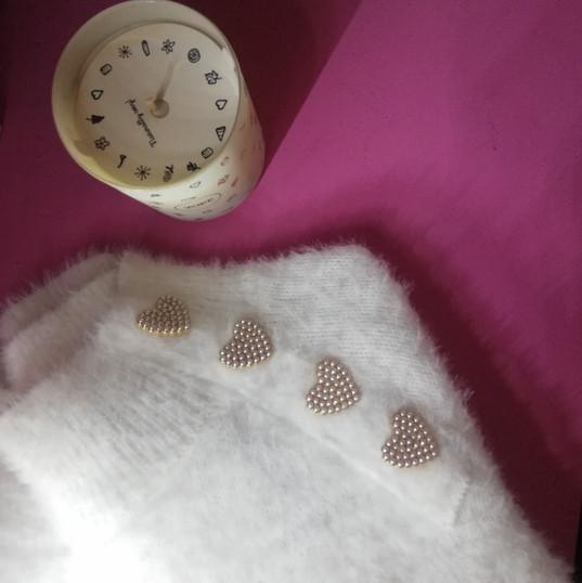 candela di soia e maglia moodette