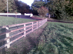 Tanalised 4 Bar P+R fence with Tornado 12-108-8 Horse wire traped between the Post and the rail