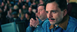 2-Jeff Gillooly (Sebastian Stan) watches a routine in I, TONYA, courtesy of NEON