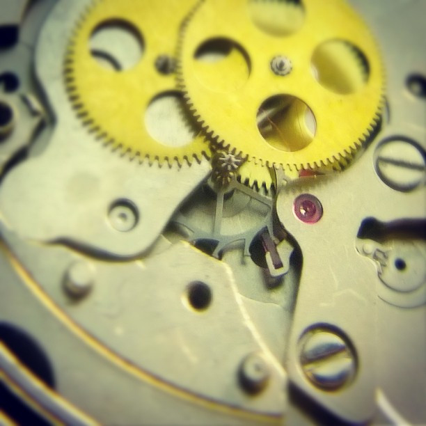 The gear train and a level escapement comprising an escapement wheel, and a pellet fork. The balance wheel is missing from the picture.