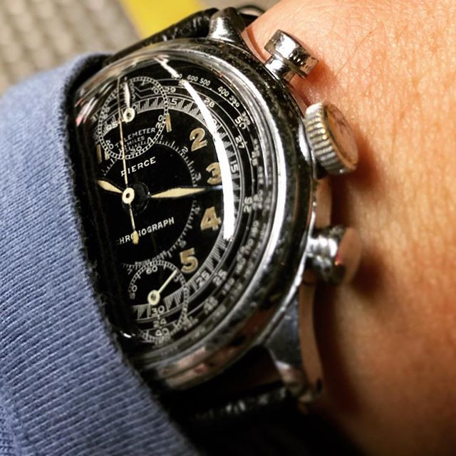 Shiny black gilt dial on a Pierce Chronograph.
