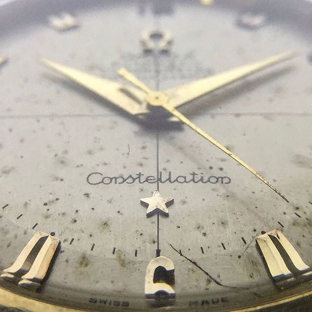 Freckles on the dial of a Omega Constellation.