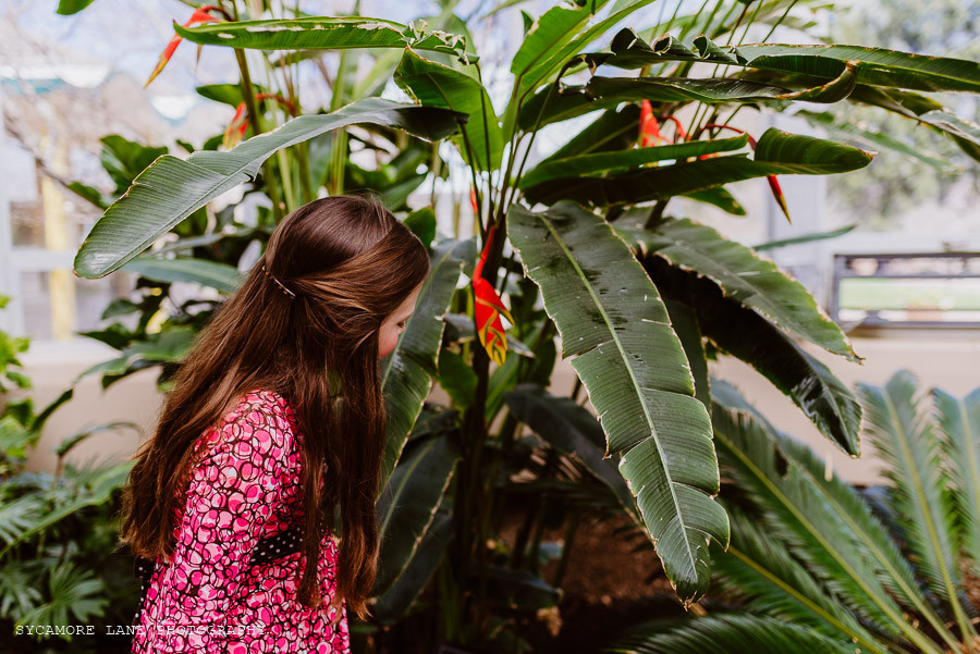 Girl looking at tropical plant