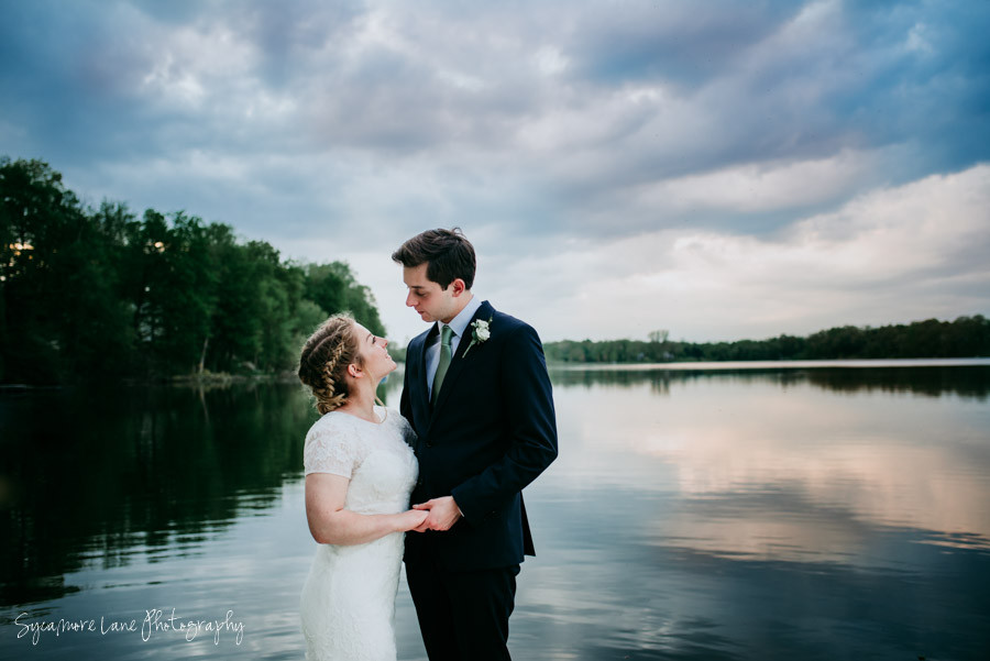 Bride and Groom looking at one another by Paradise Lake, Vandalia, Michigan