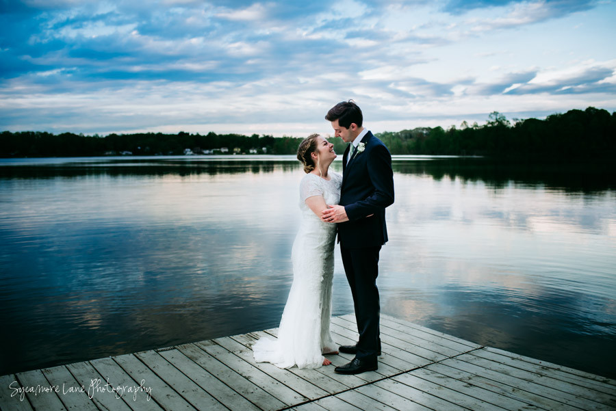 Bride and Groom laughing together by Paradise Lake, Vandalia, Michigan
