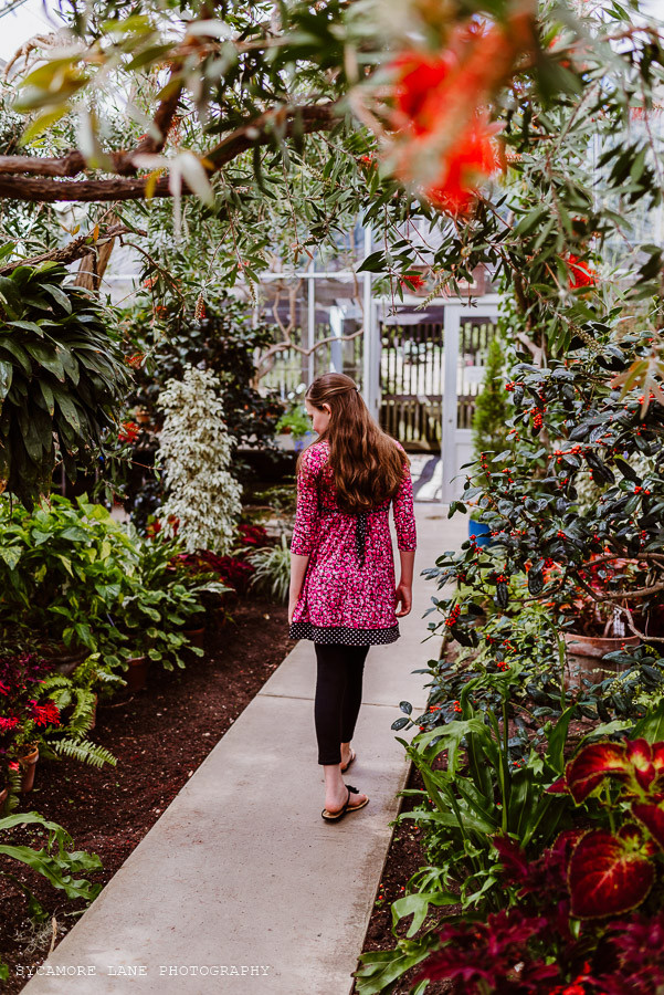 Girl walking in a conservatory