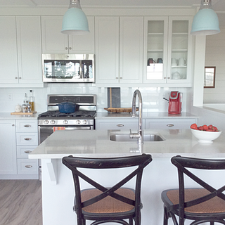 Cottage style kitchen focus on the red d