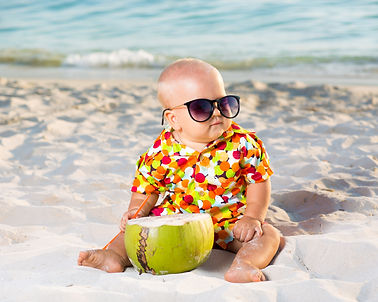 Funny baby wearing sunglasses with cocon