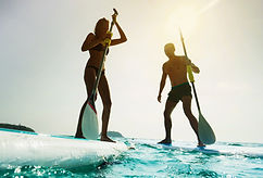 Stand up paddle board couple paddleboard