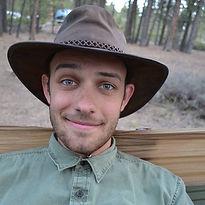 a photo of Carlo Costantno sitting in a hammock in Colorado