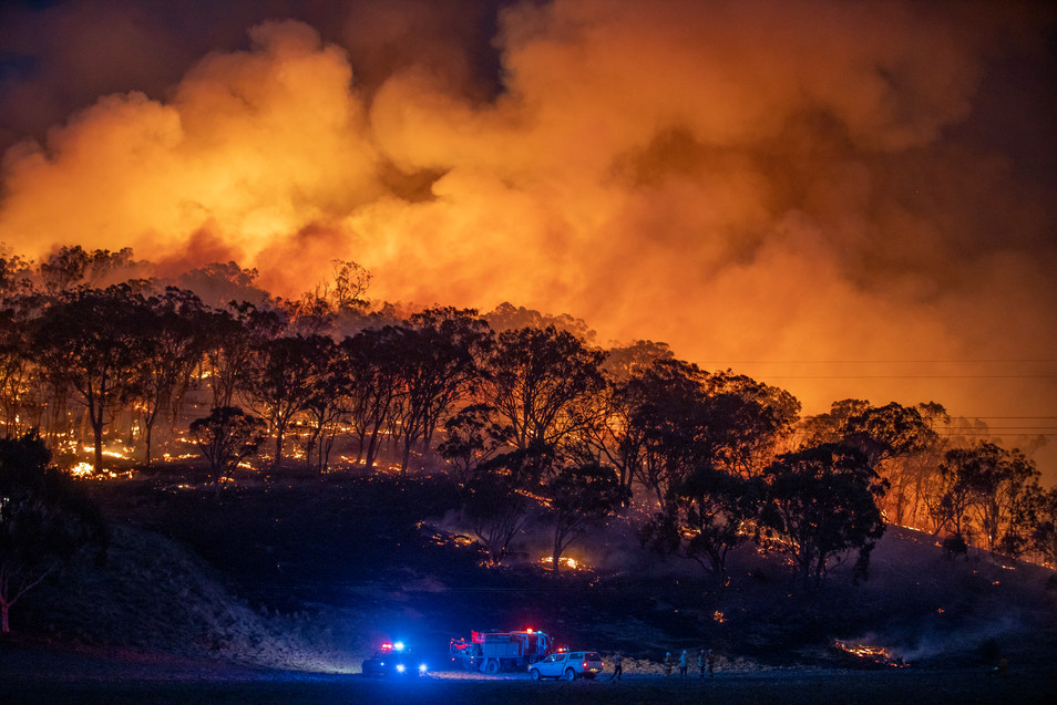Fire crews rush to a spot fire from the Clear Ridge bushfire that flared up in Michelago on  1 February 2020.