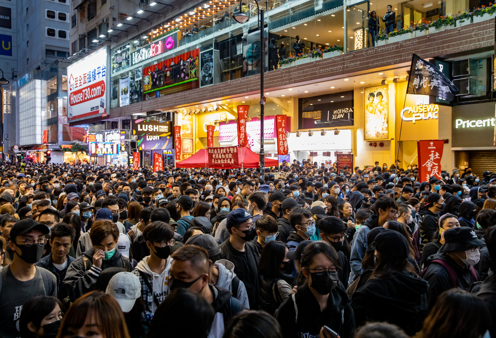 People flood Causeway Bay after police forced organisers to call off a protest march attended by over a million people on New Year's Day.