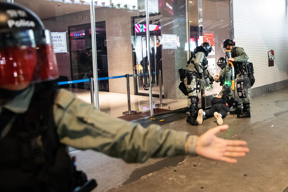Police arrest a suspected anti-government protester in Hong Kong's Causeway Bay on the evening of 1 January 2020. He was one of over 400 arrested that night.