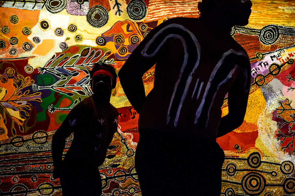 Dancers perform at the unveiling of a vast painting by artists from the Anangu Pitjantjatjara Yankunytjatjara (APY) lands in South Australia at the Australian War Memorial on 16 November 2017. The work was commissioned to depict the importance of country to Aboriginal Australians.