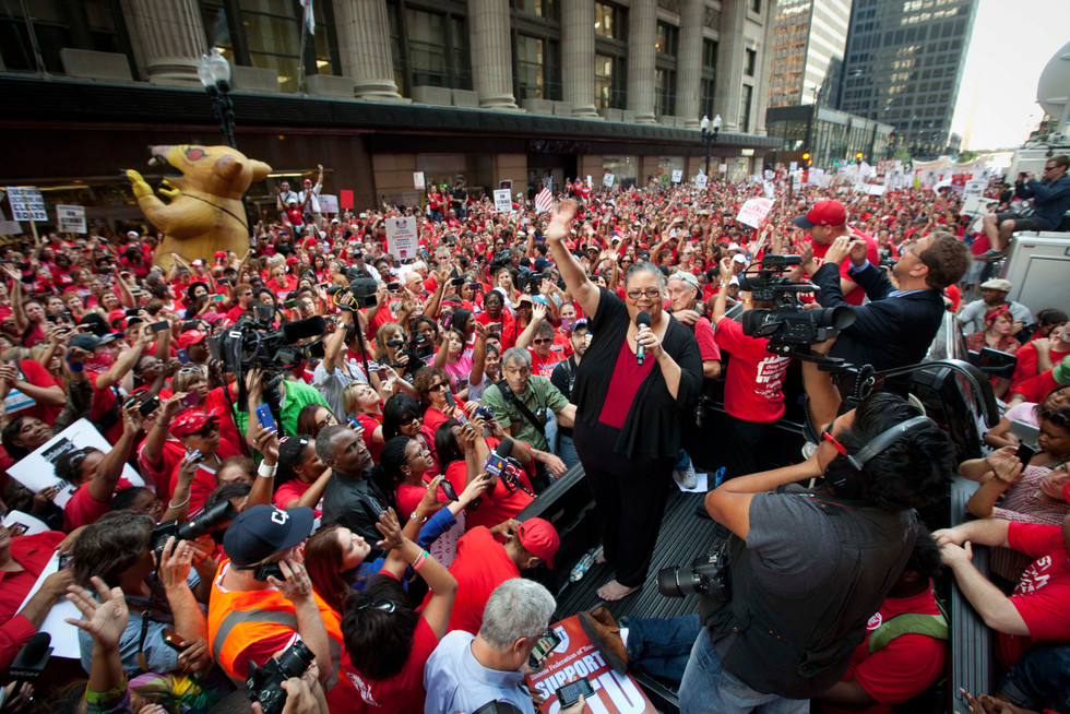 Chicago Teachers Union President Karen Lewis takes a break from negotiations over teachers' contracts with the Chicago Board of Education to address a rally of thousands of public school teachers on Tuesday, Sept. 11, 2012 in downtown Chicago. Teachers walked off the job Monday for the first time in 25 years over issues that include pay raises, classroom conditions, job security and teacher evaluations.