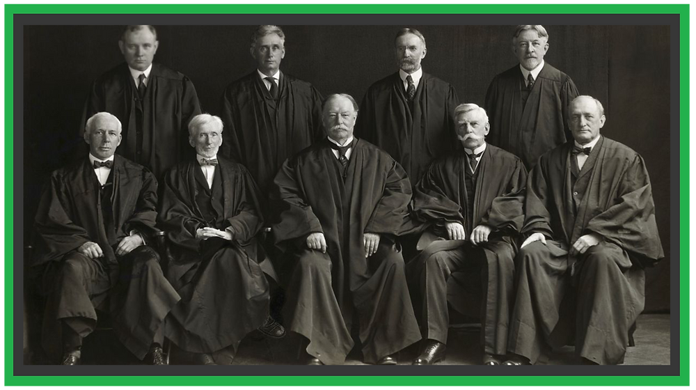 9 Supreme Court Justices wearing their black judicial gowns.