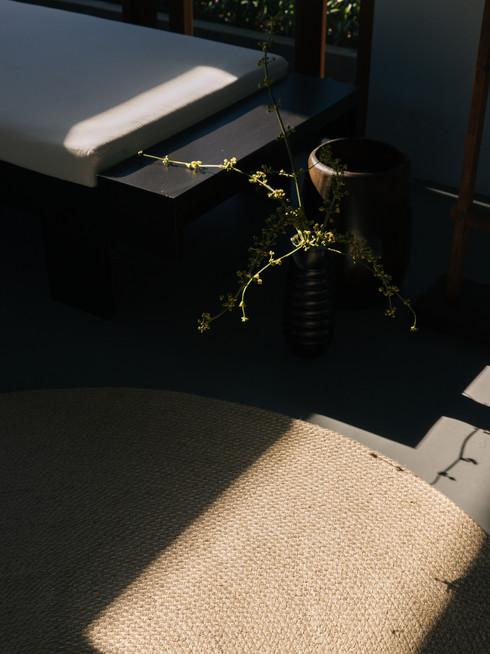 Wabi sabi Japanese interior design with large round handmade sustainable jute rug