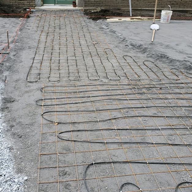 Under patio snow melt cable