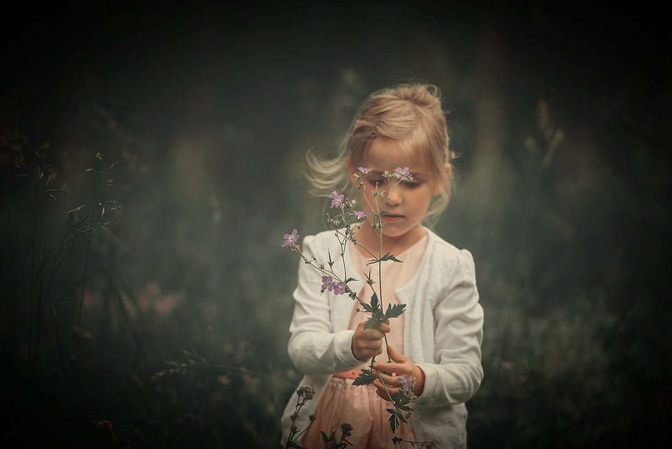 Young girl collecting flowers