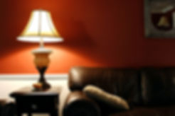 homely picture of a room with warm lighting and traditional furniture