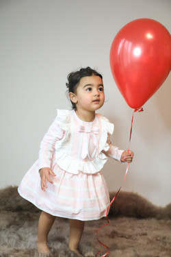 Little girl with red balloon