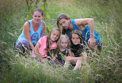 Family photography in long summer grass.