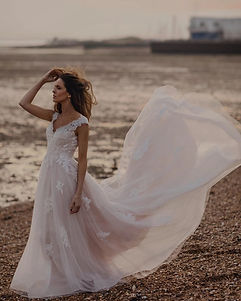 princess boho style wedding dress with lace applique details and flowy skirt with lace back
