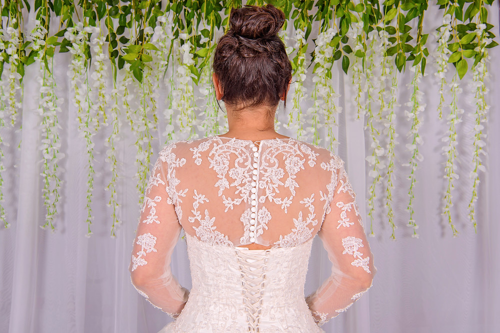 a line cathedral train lace wedding dress with long sleeves