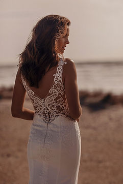 Crepe wedding dress with illusion detail and buttons