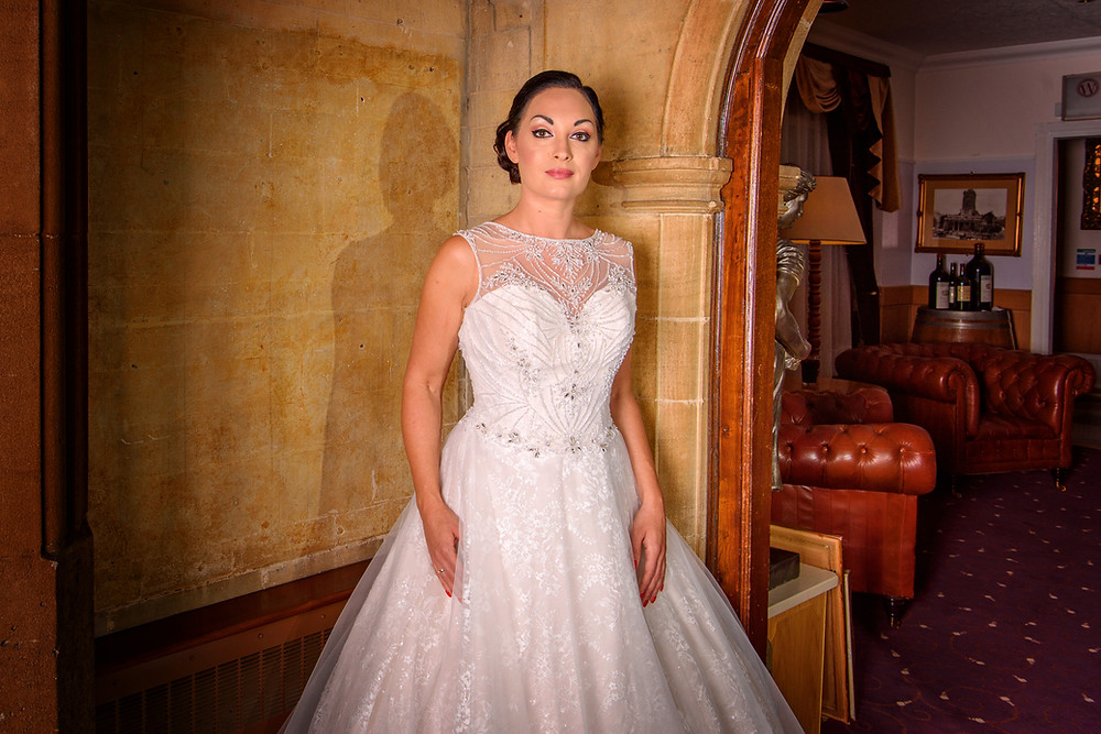 embellished and lace wedding dress with floral tulle underlay