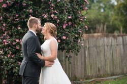 Bride, Groom, Flowers & Fence