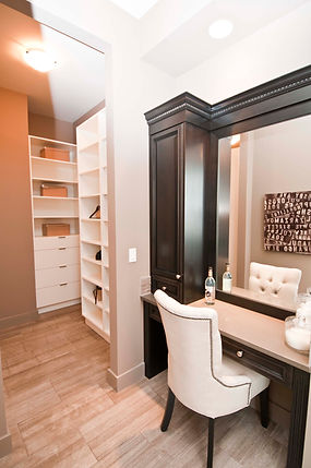 Dark stained wood custom makeup vanity and custom closet