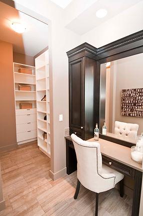 Dark stained wood custom makeup vanity and custom closet