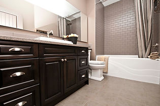 custom dark stain bathroom vanity cabinetry